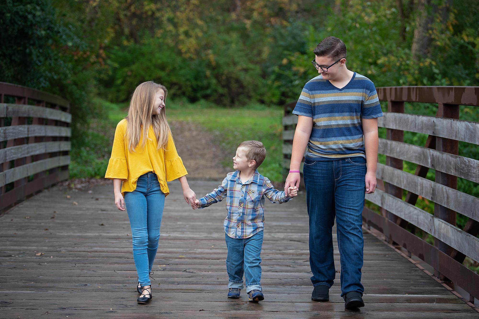 Siblings photo on bridge in park