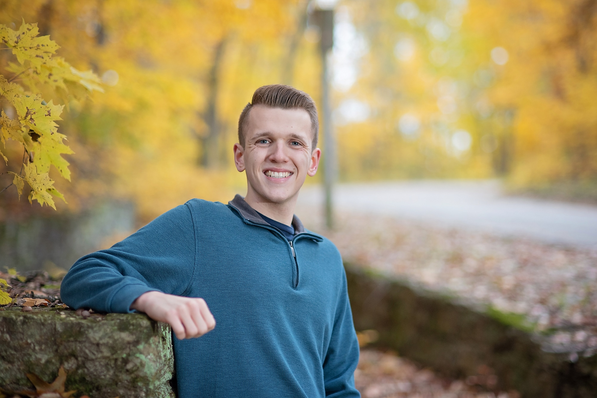 Senior Boy Photo smiling in fall leaves