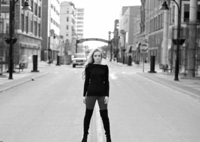 Black and White photo of senior girl in downtown Rockford, IL