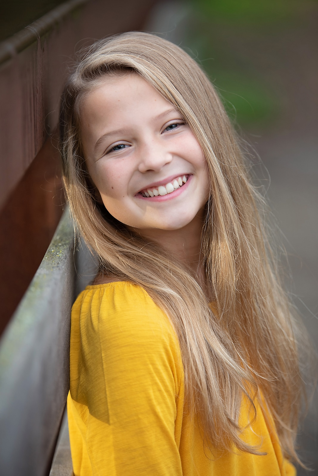 Bridge picture of Sister smiling with yellow shirt